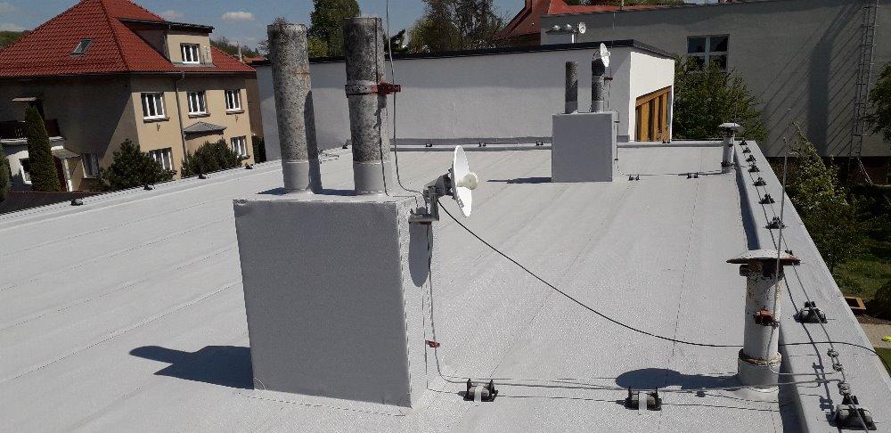 Střecha bytového domu po rekonstrukci